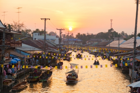 SUMUTHSONGKRAM,THAILAND-DECEMBER 30:Beautiful evening with sunset at Ampawa floating market where is the famous place to visit in Thailand on December 30,2012 in Samuthsongkram,Thailand