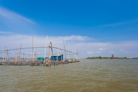 CHACHOENGSAO,THAILAND-FEBUARY 19: The Barramundi fish or Silver perch fish farm float on the sea at Takham shore on February 19,2012 in Chachoengsao,Thailand