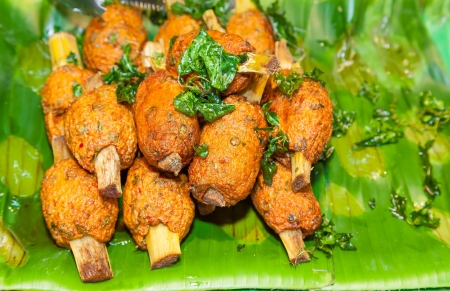 Delicious plate of Deep-fried curried fish patties on the banana leaf photo