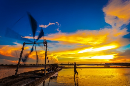 Ancient wind mill use for move the sea water into the salt field in Thailand  photo