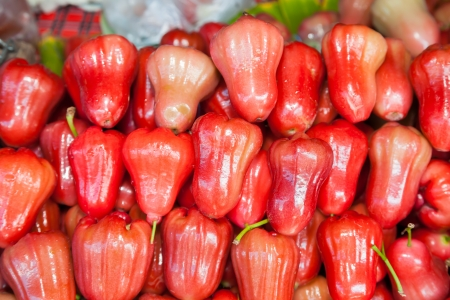 Red rose apple sell in Thai street market photo