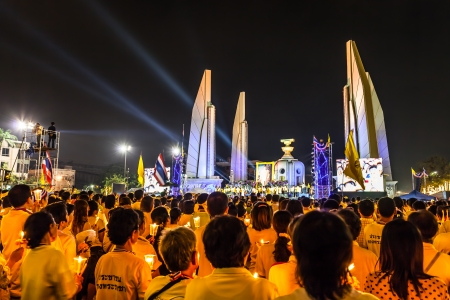 demonstrators: BANGKOK,THAILAND-DECEMBER 5 The protesters light the candle bless to the KIng Bhumibol Adulyadej birthday at Democracy monument on Ratchadumnoen road in Bangkok on December 5,2013 in Bangkok,Thailand