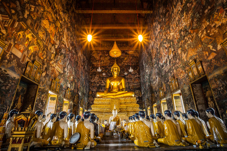 The beautiful Buddha and his disciple statue at Sutatthepwararam temple where famous place for tourist at Sutatthepwararam temple in BangkokThailand