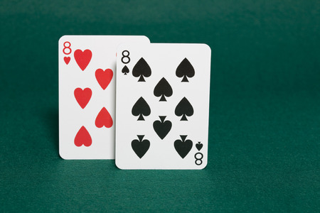 eights: Closeup of pocket pair of eights starting hand in hold
