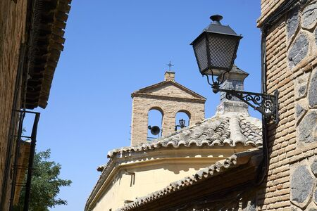 Street lamp and steeple in Toledo on midday Stock Photo