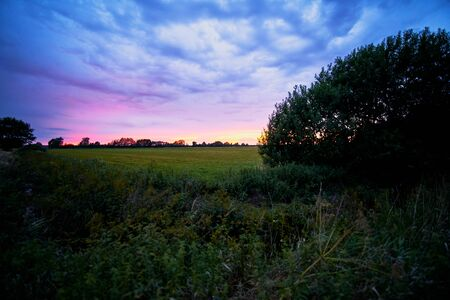 Sunset over field in the Teufelsmoor, near Worpswede, Germany Reklamní fotografie