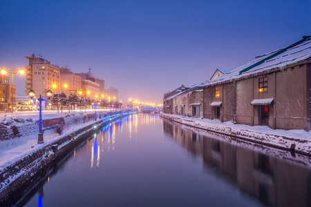 Otaru Canal in Winter Evening, people are walking alongside canal, long exposure, Hokkaido, Japan