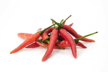 spermatozoon: Handful of red hot Thai chili papers on white background