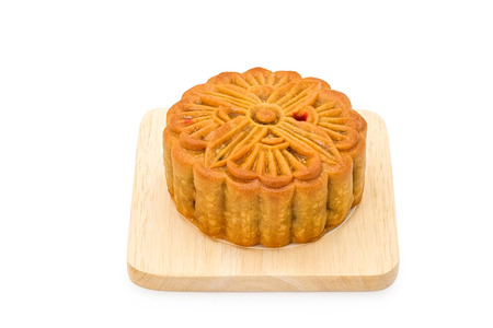 asian foods: Mooncake on wooden plate for the chinese Mid Autumn festival, on white background