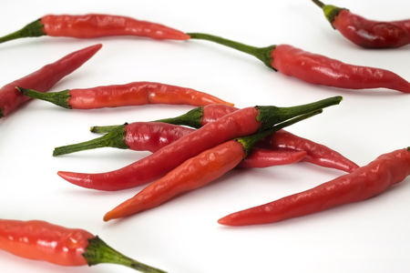 handful: Handful of red hot Thai chili papers on white background