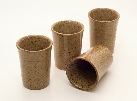stoneware: Set of four unusual decorative stoneware cups
