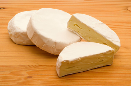 ripened: three pieces of traditional delicious ripened cheese Stock Photo