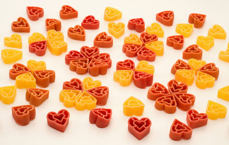 dichromatic: Red and yellow hearts made from pasta Stock Photo