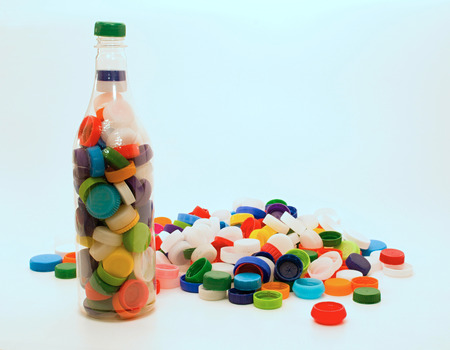 wastage: Plastic bottle and many caps for recycling