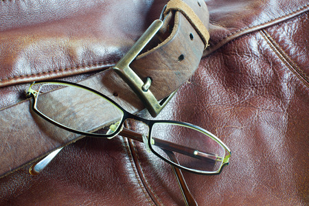 leather bag: Modern glasses on brown leather bag background Stock Photo