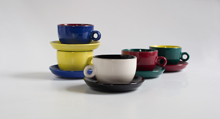 saucers: Set of varicolored small cups with saucers