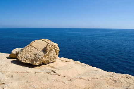 costal: Stone on the costal rock and blue ocean