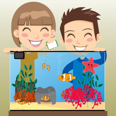 animal feed: Boy and girl siblings feeding little clownfish in their fish tank