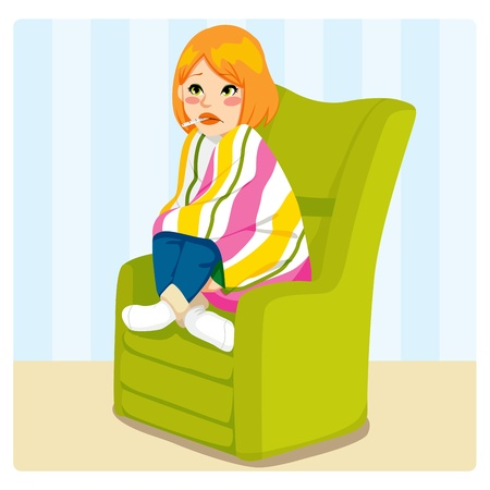 feverish: Cute woman sick with a thermometer on her mouth sitting on a green sofa chair with a blanket