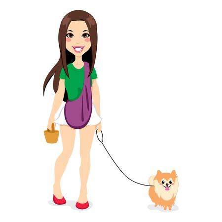 Hermosa joven caminando con un lindo perrito pomeranian
