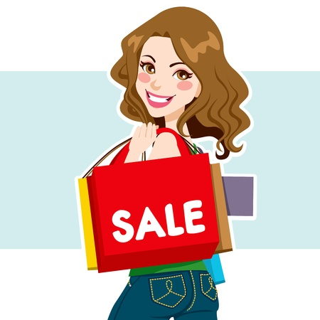 happy shopper: Pretty light brown haired woman carrying shopping bags from sale