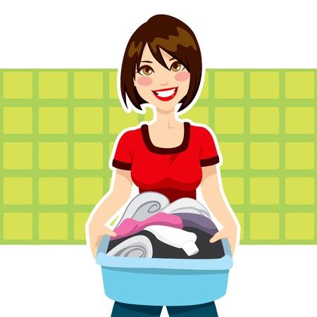 housekeeping: Mujer joven feliz celebraci�n de lavander�a ropa tareas cesta