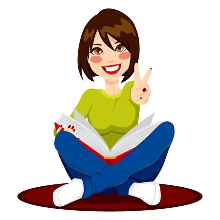 Mooi meisje zittend op een rode loper het lezen van een boek bestuderen voor klasse examens en het maken van V-teken