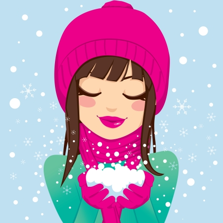 Beautiful brunette woman with eyes closed and smiling in pink winter hat and scarf holding snow with her hands