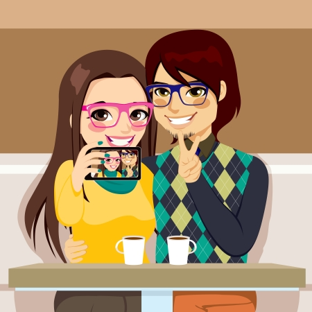 Young couple taking selfie photo together with mobile phone camera at a coffee shop