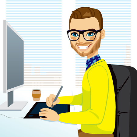 Happy hipster fashion style graphic designer man working with tablet in front of computer screen