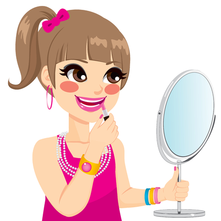look in mirror: Cute little girl playing grown up with pink lipstick makeup while looking on mirror