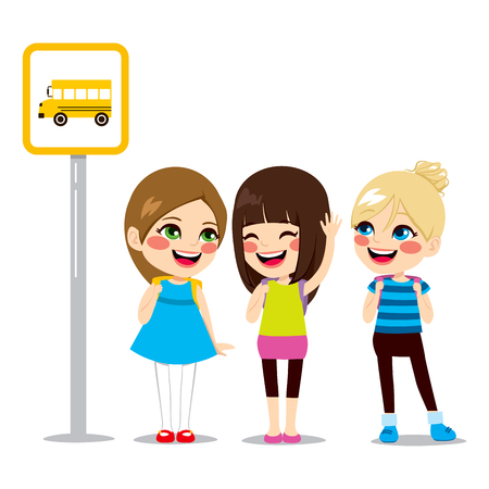 to go: Three cute schoolgirls waiting on bus stop to ride schoolbus to school
