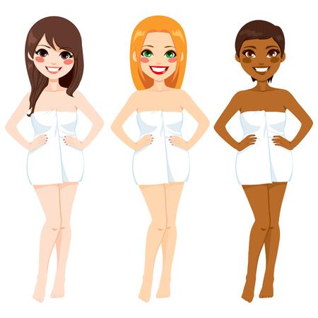 異なる肌のトーンの色と新鮮な白いタオルに包まれた体を持つ 3 人の美しい女性