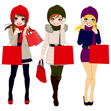 Three beautiful young women in winter clothes happy walking carrying shopping bags