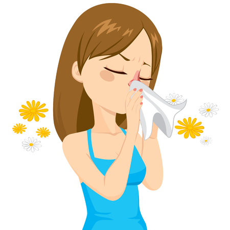 Beautiful brown haired girl sneezing blowing nose on white tissue because of spring allergy