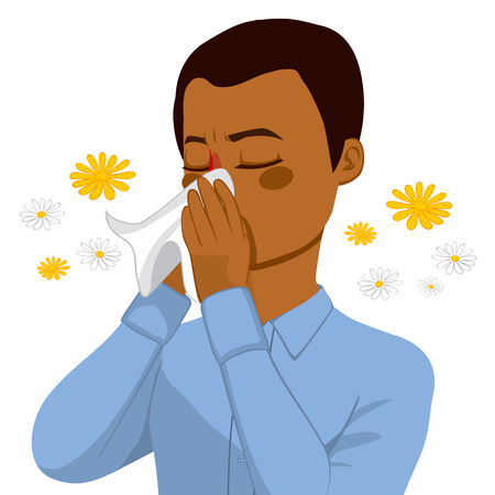 sneezing: Young brown haired african american man sneezing blowing nose on white tissue because of spring allergy