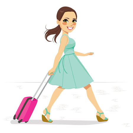 Beautiful woman in mint green dress walking on street pulling small pink roller suitcase