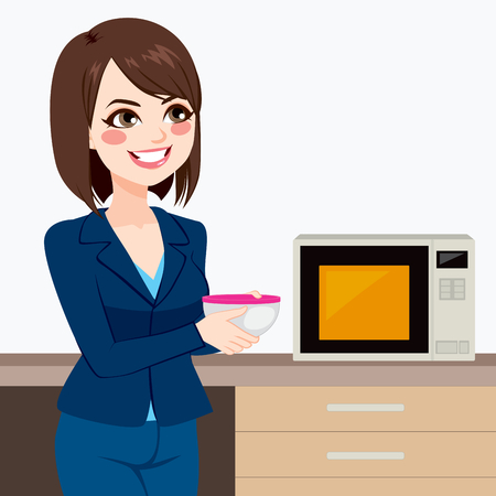 potluck: Beautiful brunette businesswoman using microwave to heat homemade food on business office kitchen