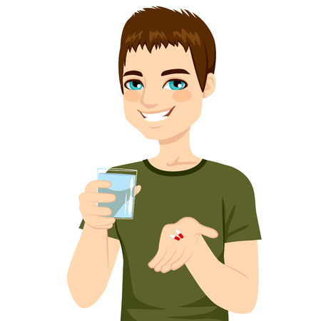 Young attractive man taking pills with glass of water