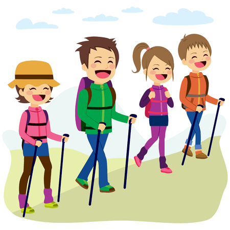 Happy family climbing mountain with sticks on a trip vacation day