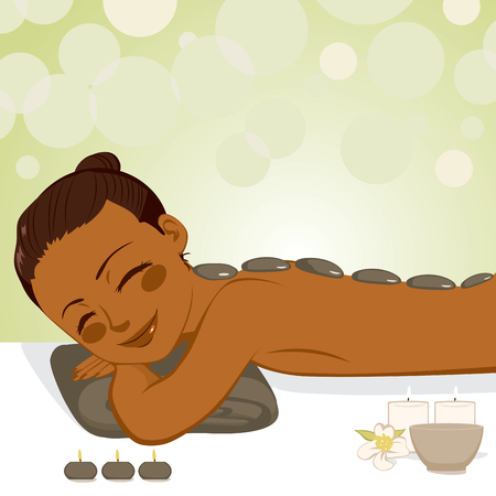 Beautiful African American young woman enjoying relaxing hot stone massage with soft light candles at beauty parlor Vectores