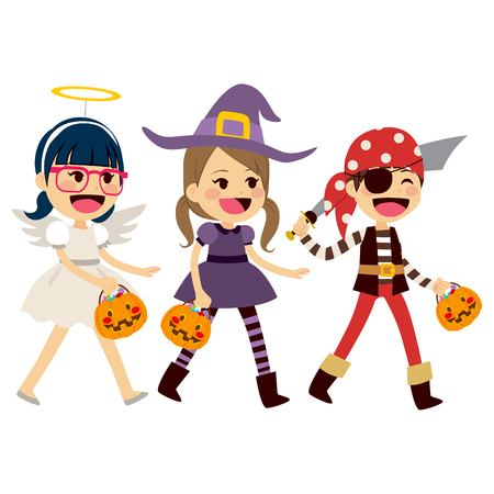 dress up: Cute little children in costumes walking for trick or treat candies on Halloween