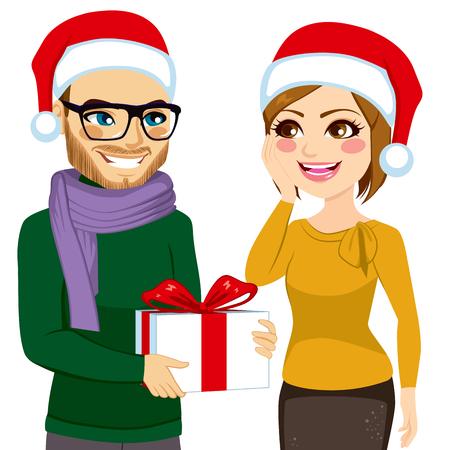 caucasian: Cute young caucasian woman receiving big present box from boyfriend celebrating Christmas