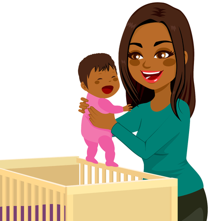 child bedroom: Beautiful young African American mom picking little baby from crib