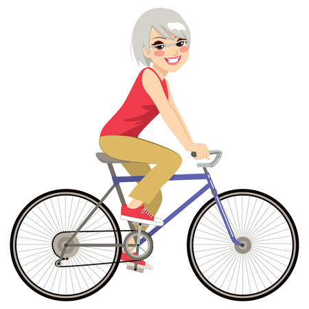 senior exercise: Beautiful senior woman riding bicycle happy side profile view