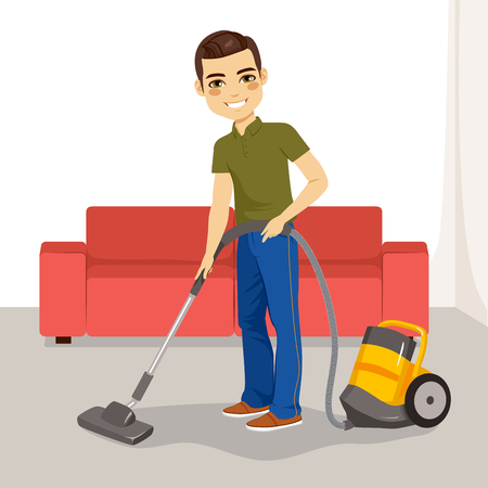 couches: Young man using vacuum cleaner on his living room