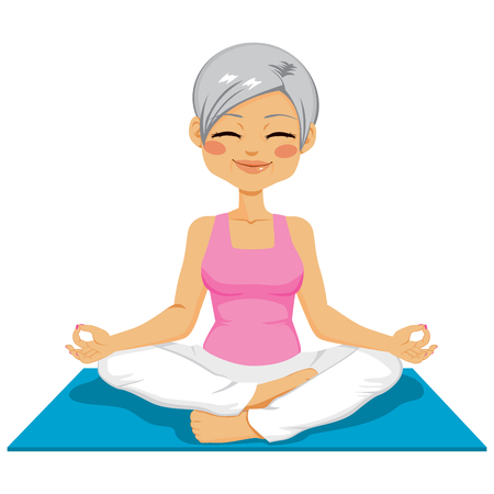 physical activity: Mature senior woman practicing zen position on yoga mat isolated on white background