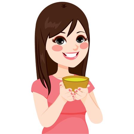 belle brune: Belle jeune femme brune asiatique ayant le thé vert sain