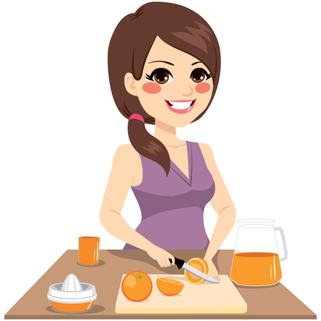 preparing: woman cutting oranges with knife preparing healthy organic juice