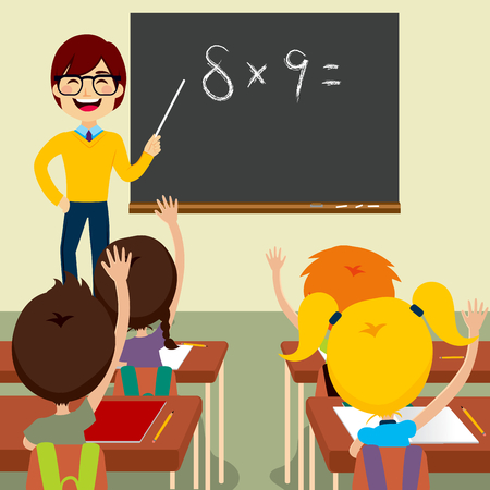 Happy young male teacher standing asking maths lesson to children raising hands up sitting in classroom